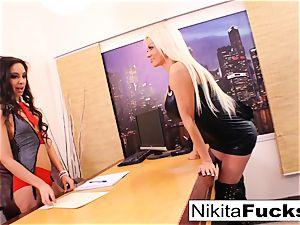 Nikita's girly-girl office screw