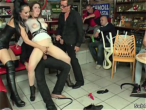 domme in leather predominates gimp in public