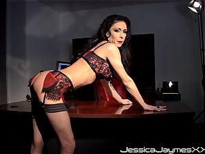 horny brunette Jessica Jaymes fingers her delicious cootchie pie in her office