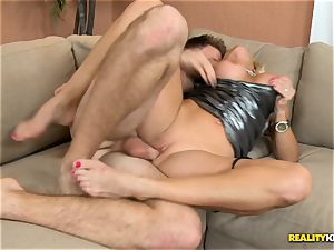 Dani Dare plumbed on the bed