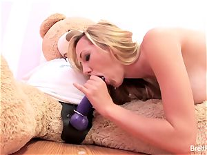 Brett Rossi plays with a jammed bear's strap-on fuck stick