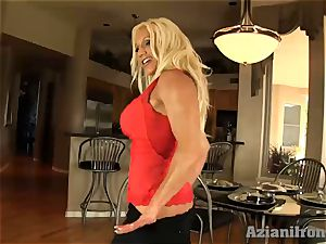 Buff nymph slips black faux-cock in her humid twat