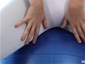 Alexis Adams plumbs via a gym ball