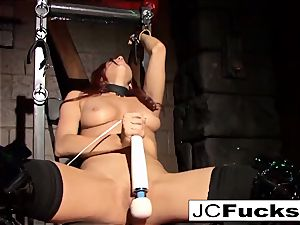 bound sweetheart satiates herself while still shackled up