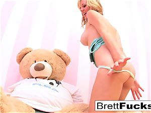 Brett Rossi plays with a strap-on faux-cock