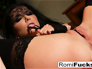 Romi sticks her beaver utter of panties